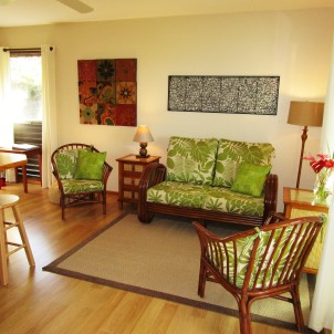 The living room has space to relax, read or watch TV. Large sliding glass doors lead to the lanai.